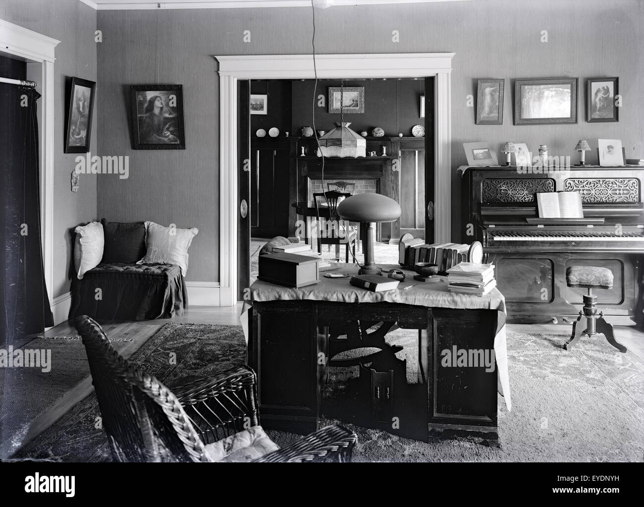 Antique c1910 photograph of a late Victorian, circa 1910s parlor with upright piano and furnishings. See Alamy image Stock Photo
