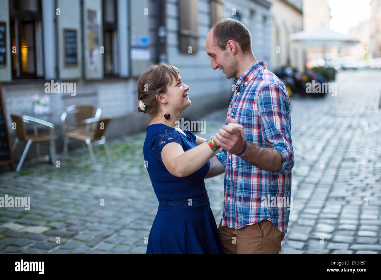 Young couple dancing on the street of the old town. Newlyweds on their honeymoon. - Stock Image