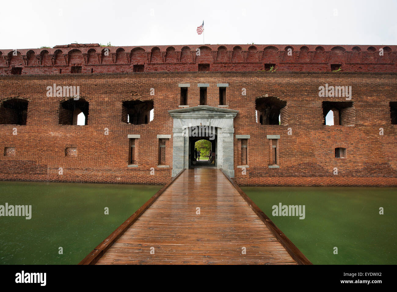 Entrance across a moat into Fort Jefferson, Dry Tortugas National Park, Florida, United States of America - Stock Image