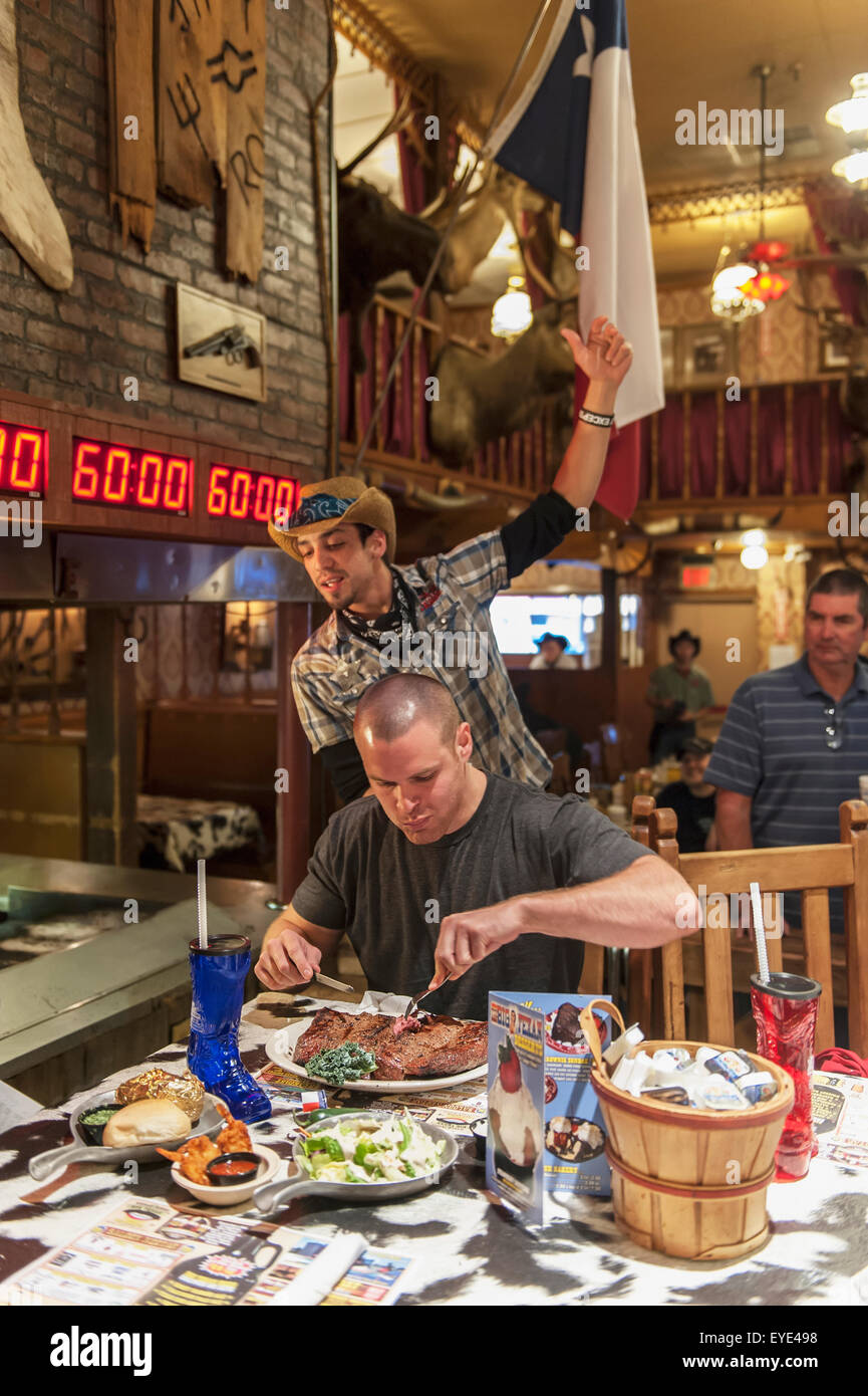 Male Contestant Begins An Attempt At The 72 Oz Steak Challenge, The Big Texan Steak Ranch Restaurant, Amarillo, - Stock Image