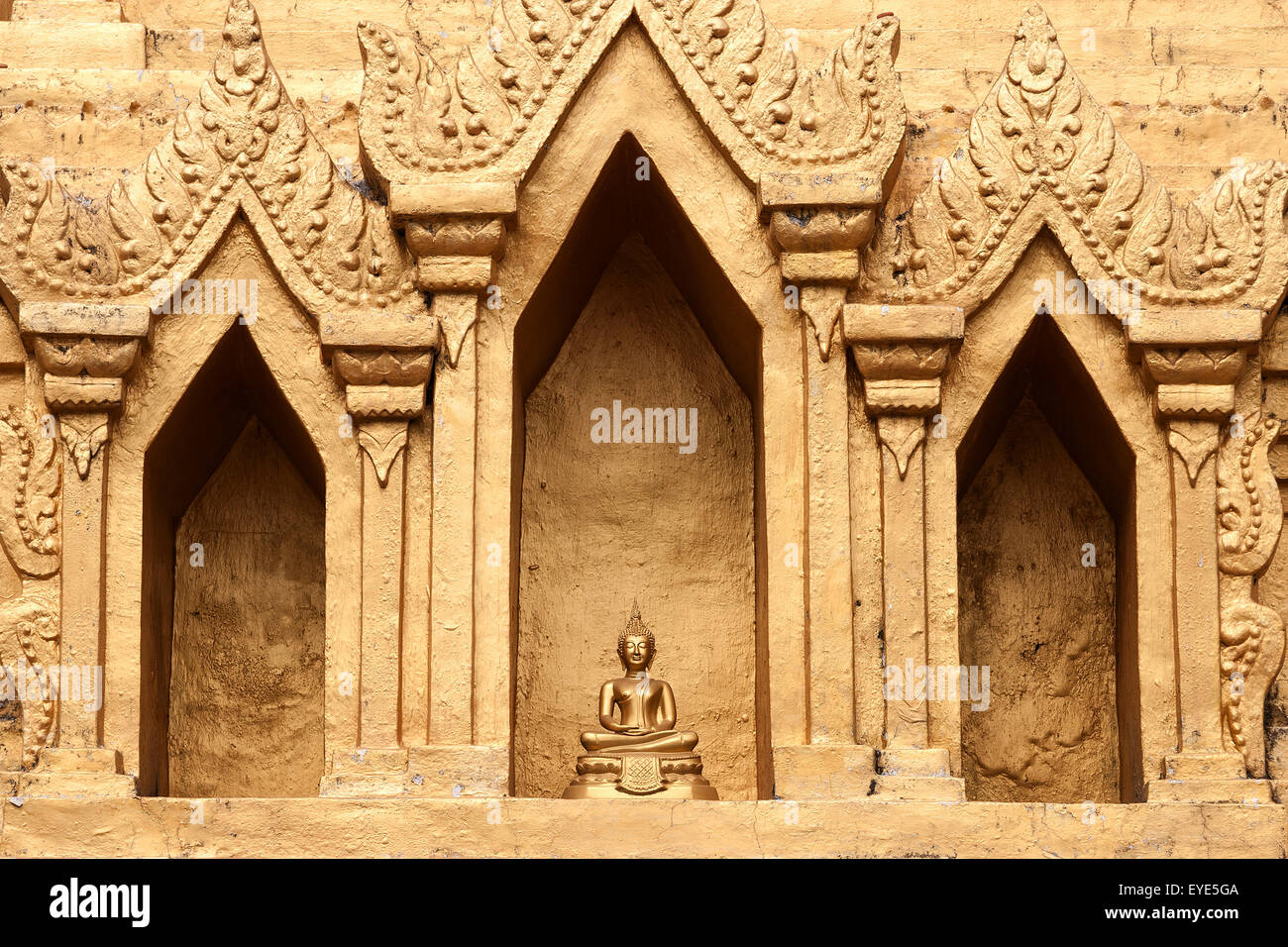 Small Buddha statue in a niche of the Wat Jong Kham, Kyaing Tong, Golden Triangle, Shan State, Myanmar Stock Photo