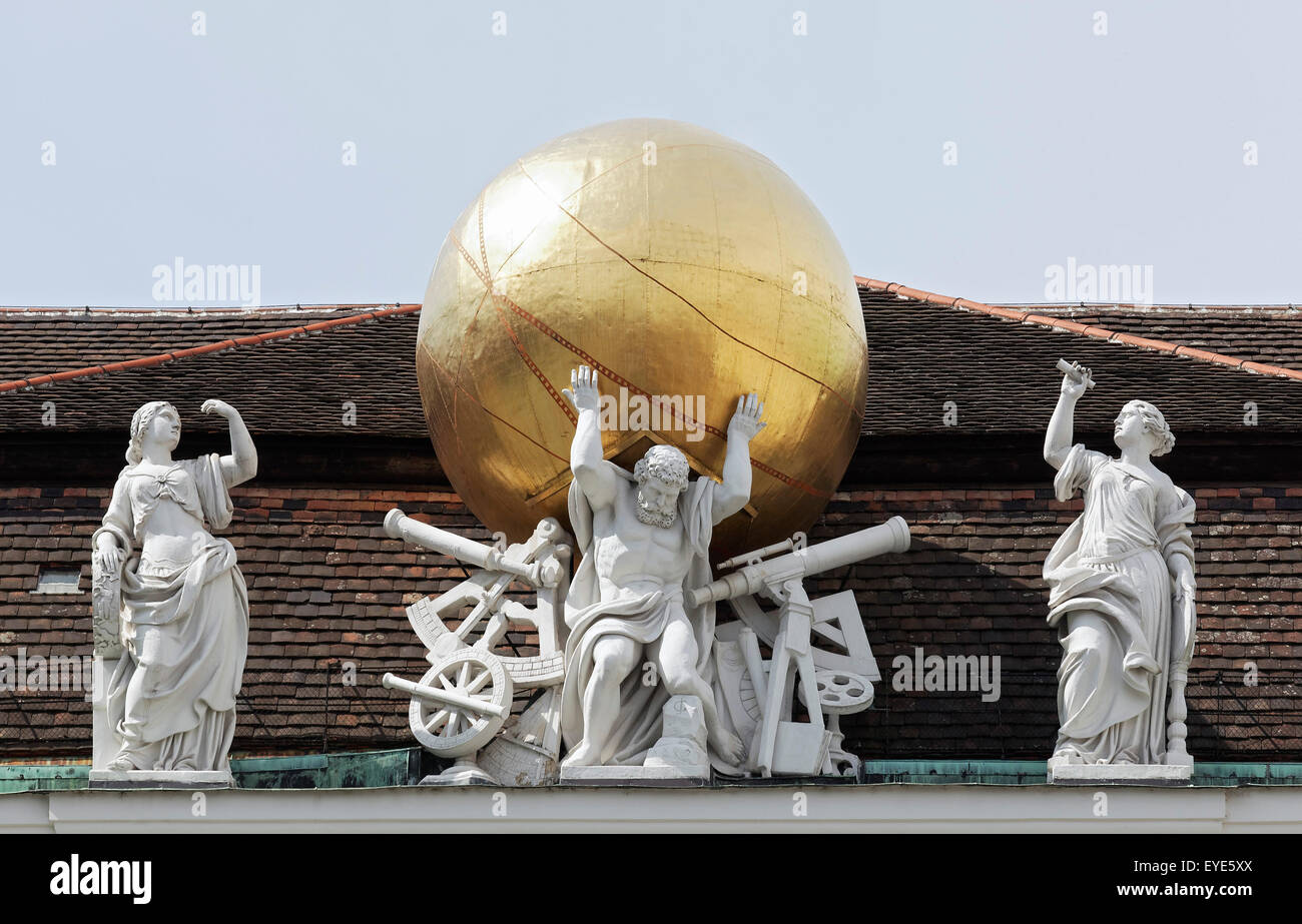 Atlas carrying the firmament on his shoulders, mythological figures on the roof of the National Library, Josefsplatz, - Stock Image
