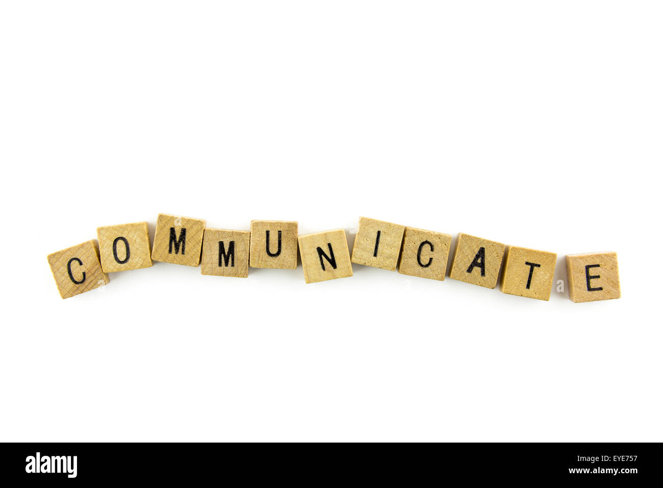 Communicate word wooden alphabet blocks on white background from top view - Stock Image