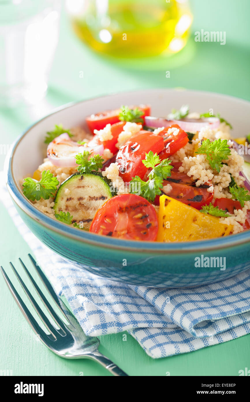 healthy couscous salad with tomato pepper zucchini onion - Stock Image