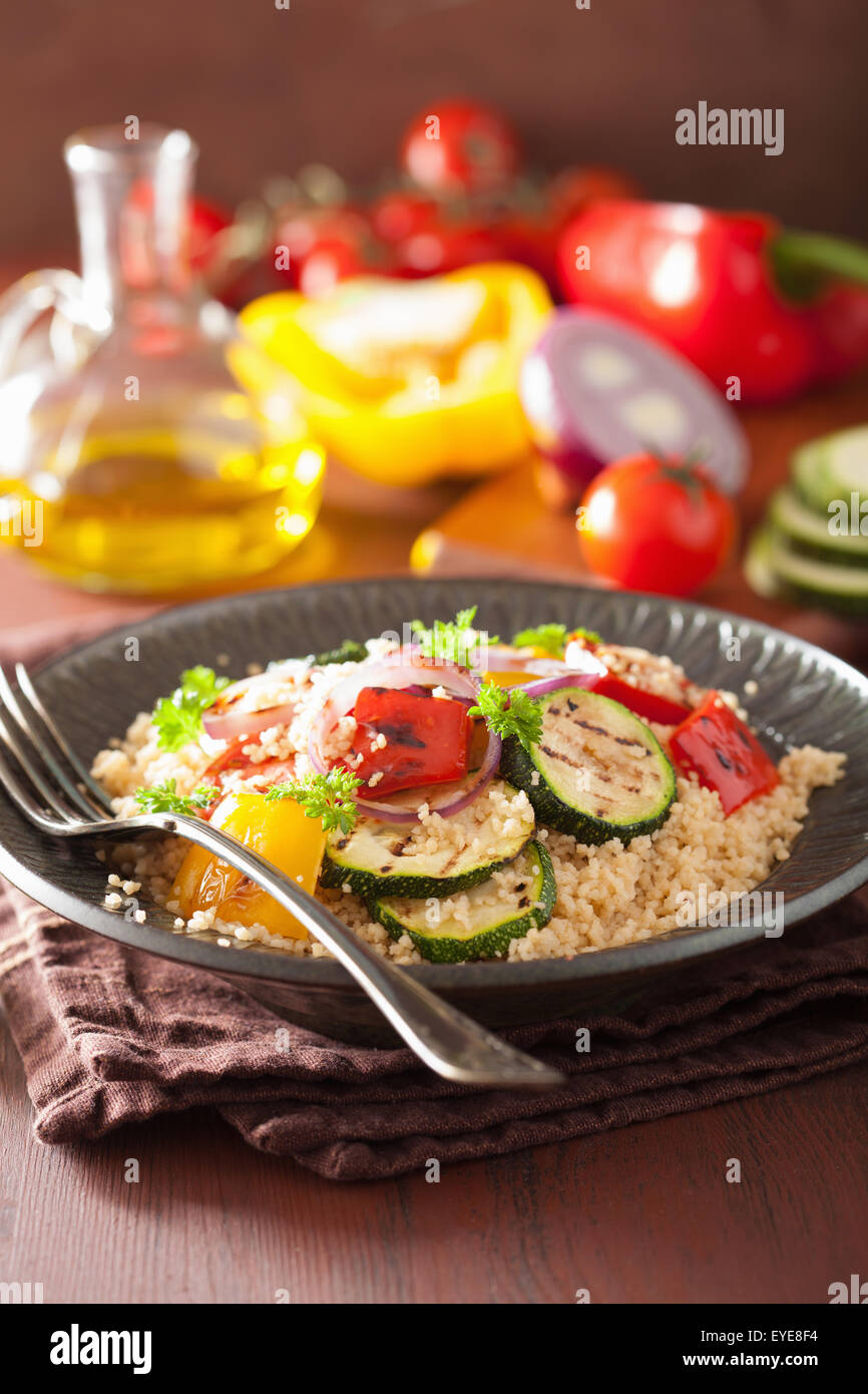 healthy couscous salad with tomato pepper zucchini onion Stock Photo