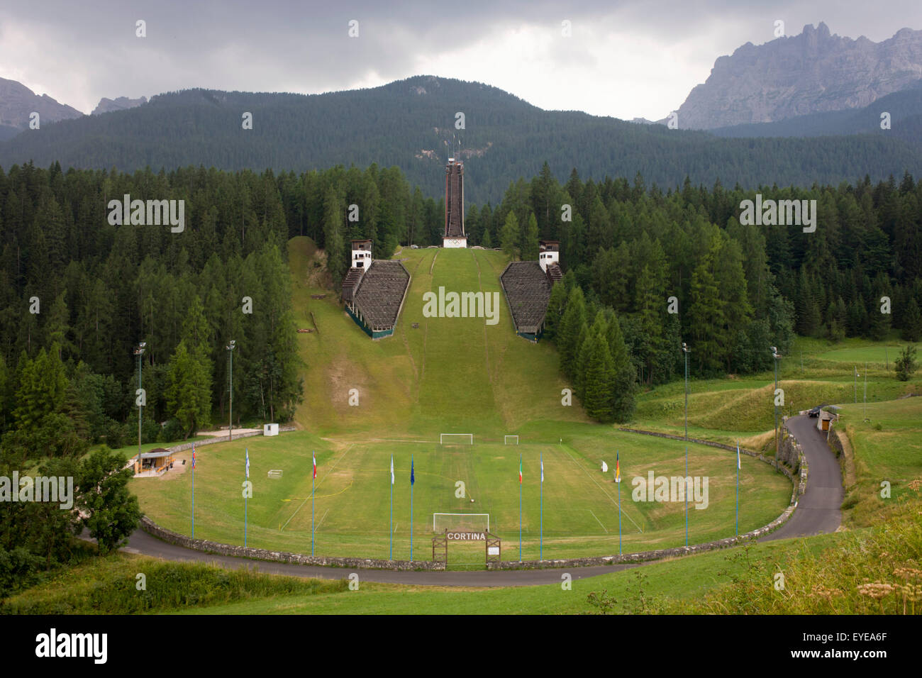 Landscape showing the ski jump for the 1956 Olympics in the city of Cortina d'Ampezzo, Veneto, Italy. - Stock Image