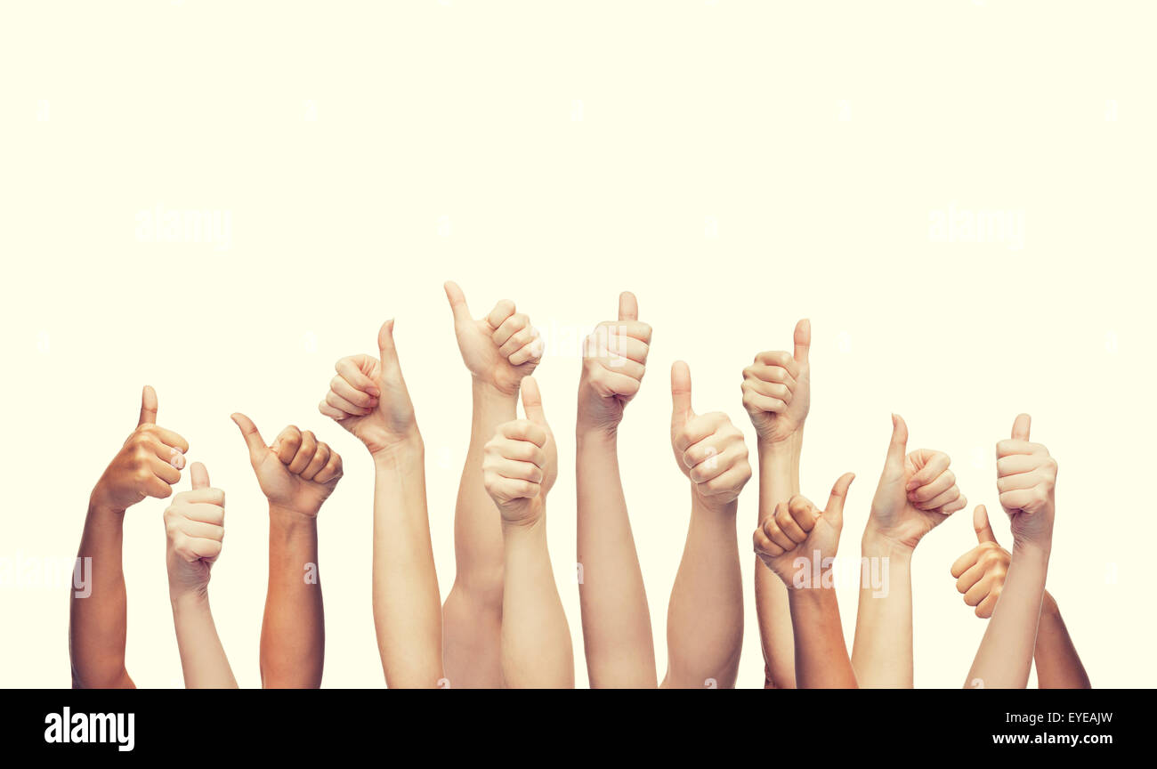 human hands showing thumbs up - Stock Image