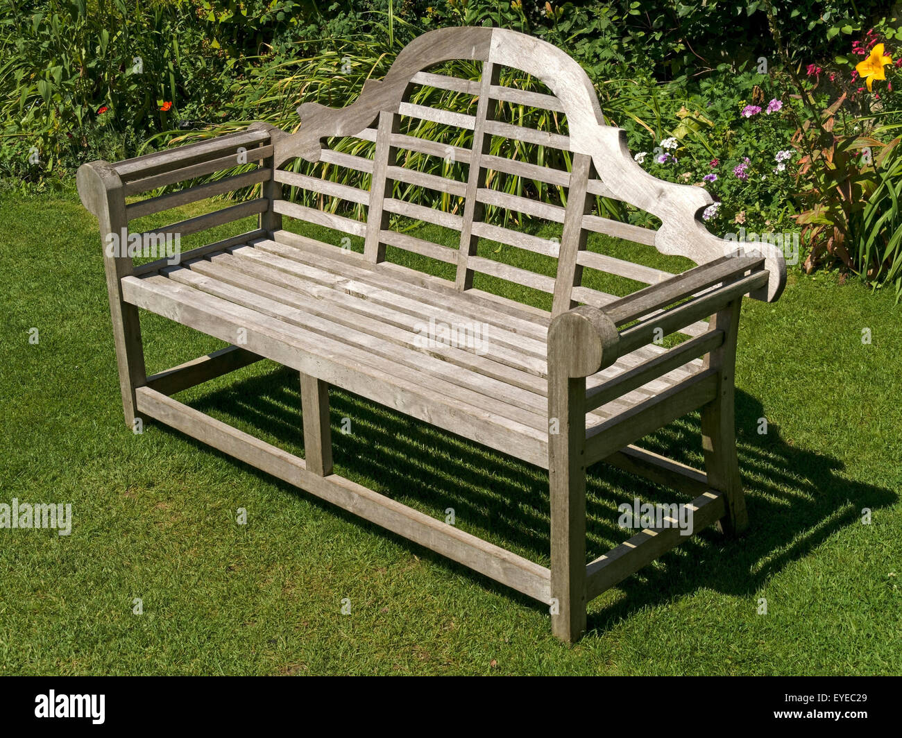 Beau Ornate Wooden Garden Bench Seat On Green Lawn, Barnsdale Gardens, Rutland,  England,