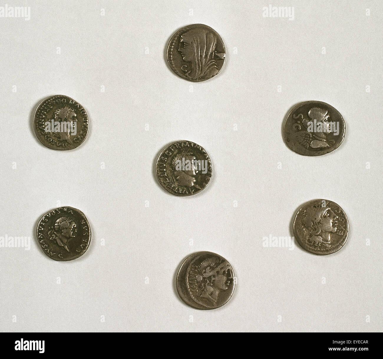 Denarius. Roman silver coin. Adverse. Roman emperors. Effigies: Trajan, Domitian and Vespasian. 268 Bc-360. Provincial Stock Photo