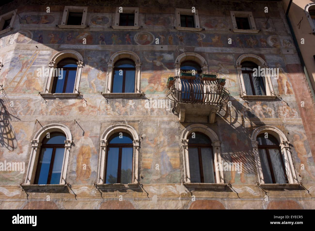Fresco facades on historic buildings in Piazza Duomo, Trento. Stock Photo