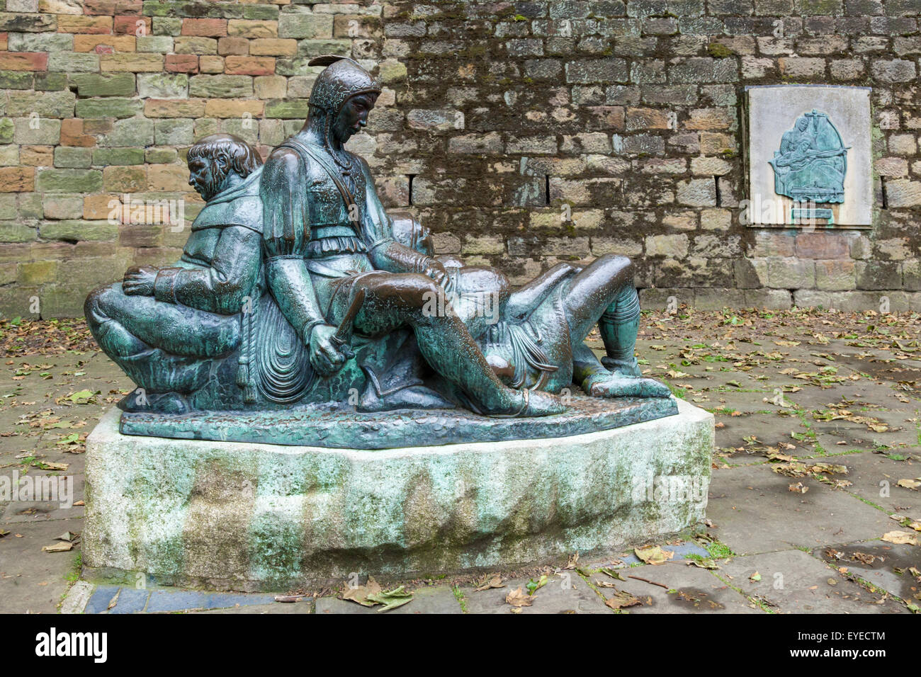 Sculpture of the Merry Men, Friar Tuck, Will Scarlet and Little John, next to the walls of Nottingham Castle, England, - Stock Image