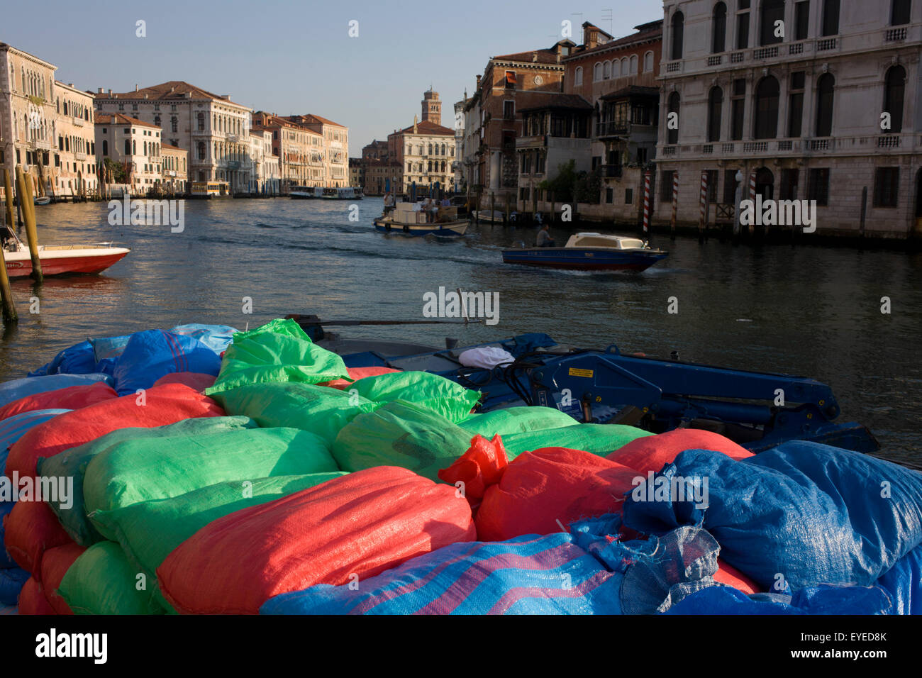 Sacks of supplies ready for unloading from a boat on the Grand Canal, Venice. - Stock Image