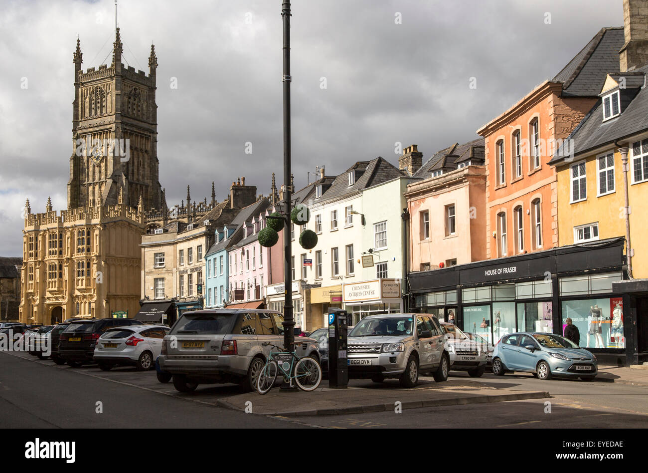 Church and historic buildings in town centre, Cirencester, Gloucestershire, England, UK, - Stock Image