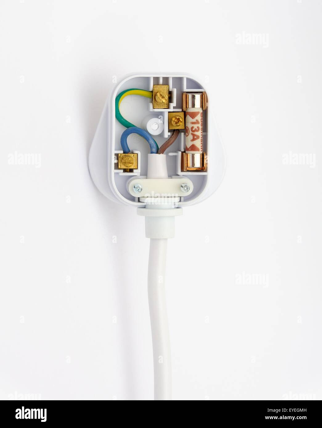 A 13 amp fused domestic plug showing the internal wiring layout. - Stock Image