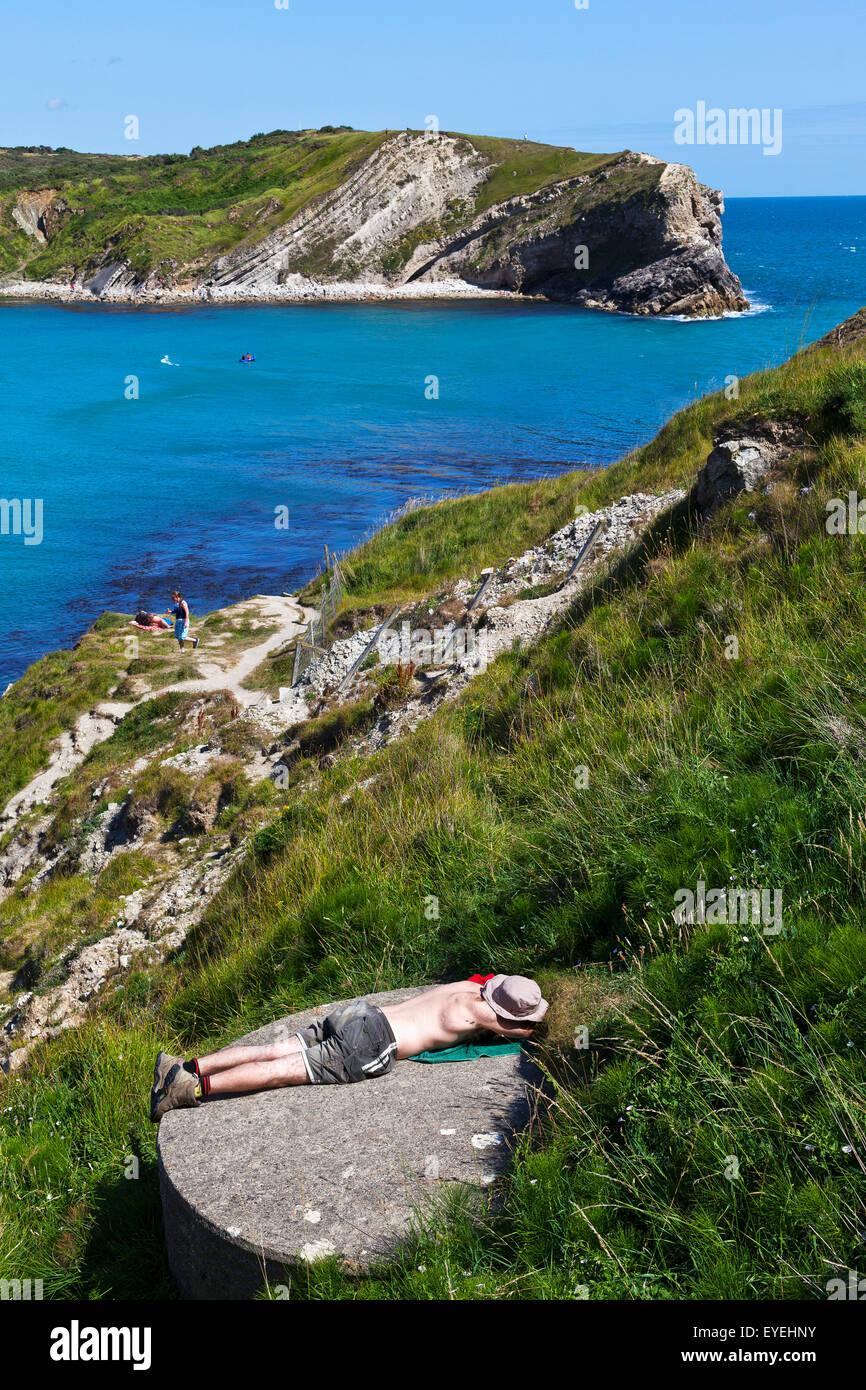 Sunbather, Lulworth cove; Dorset, England - Stock Image