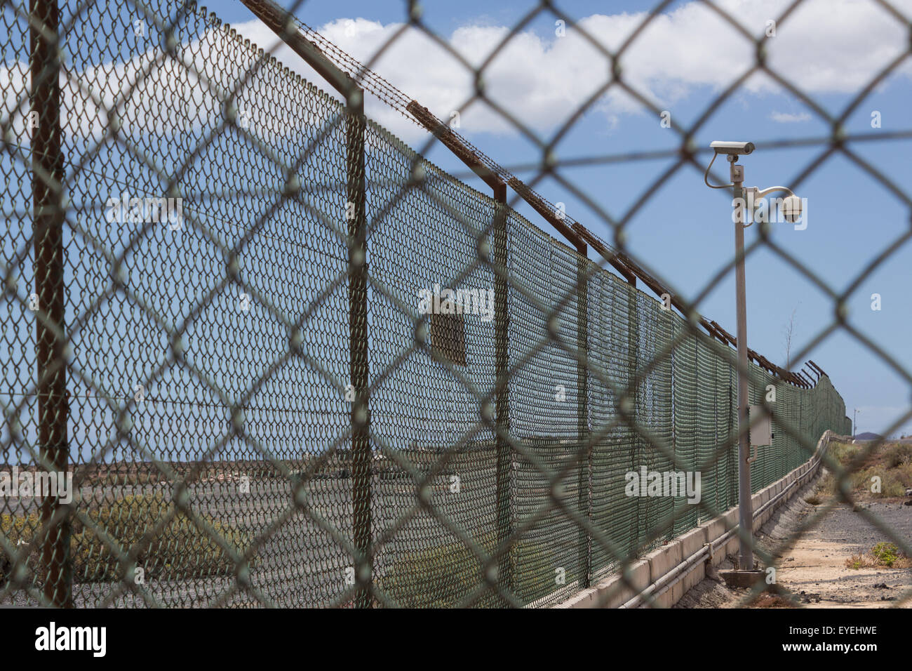 guarded border security fence and cameras stock photo 85758554