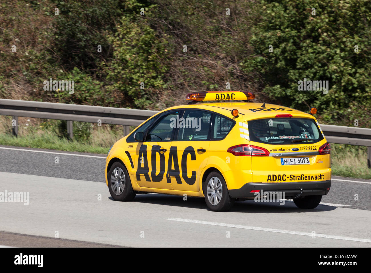 Yellow ADAC Ford S-Max on the highway A5 near. The ADAC (Allgemeiner Deutscher Automobil-Club) is an automobile - Stock Image