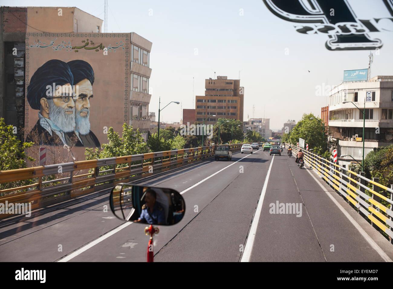 Wall portraits of Supreme Leader Ayatollah Ali Khamenei and Ayatollah Khomeini, beside expressway, Central Tehran; Stock Photo