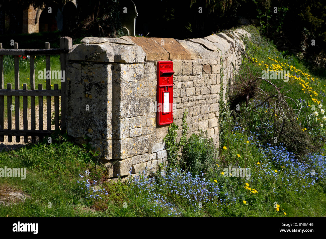 Wall postbox in Cotswold village of Swerford - Stock Image