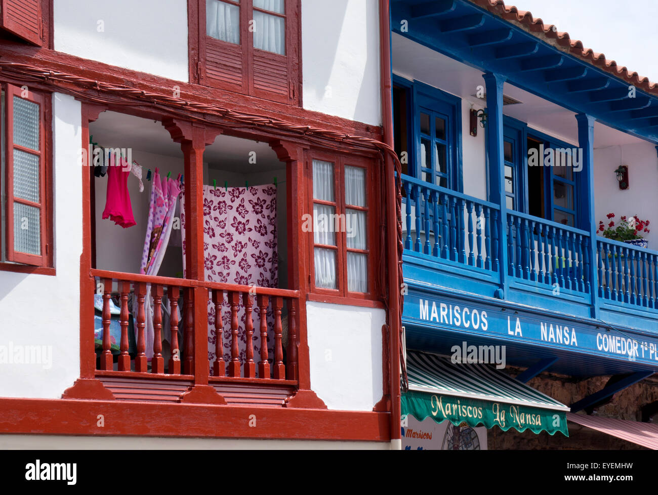Traditional style balconies in Seaside village of Tazones,Asturias,Northern Spain - Stock Image