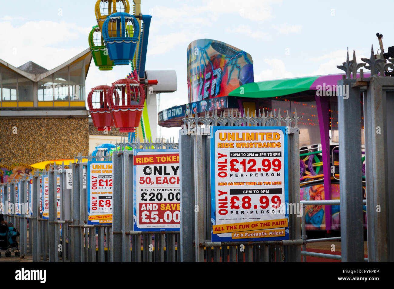 Fairground ride prices for wristbands signs Stock Photo