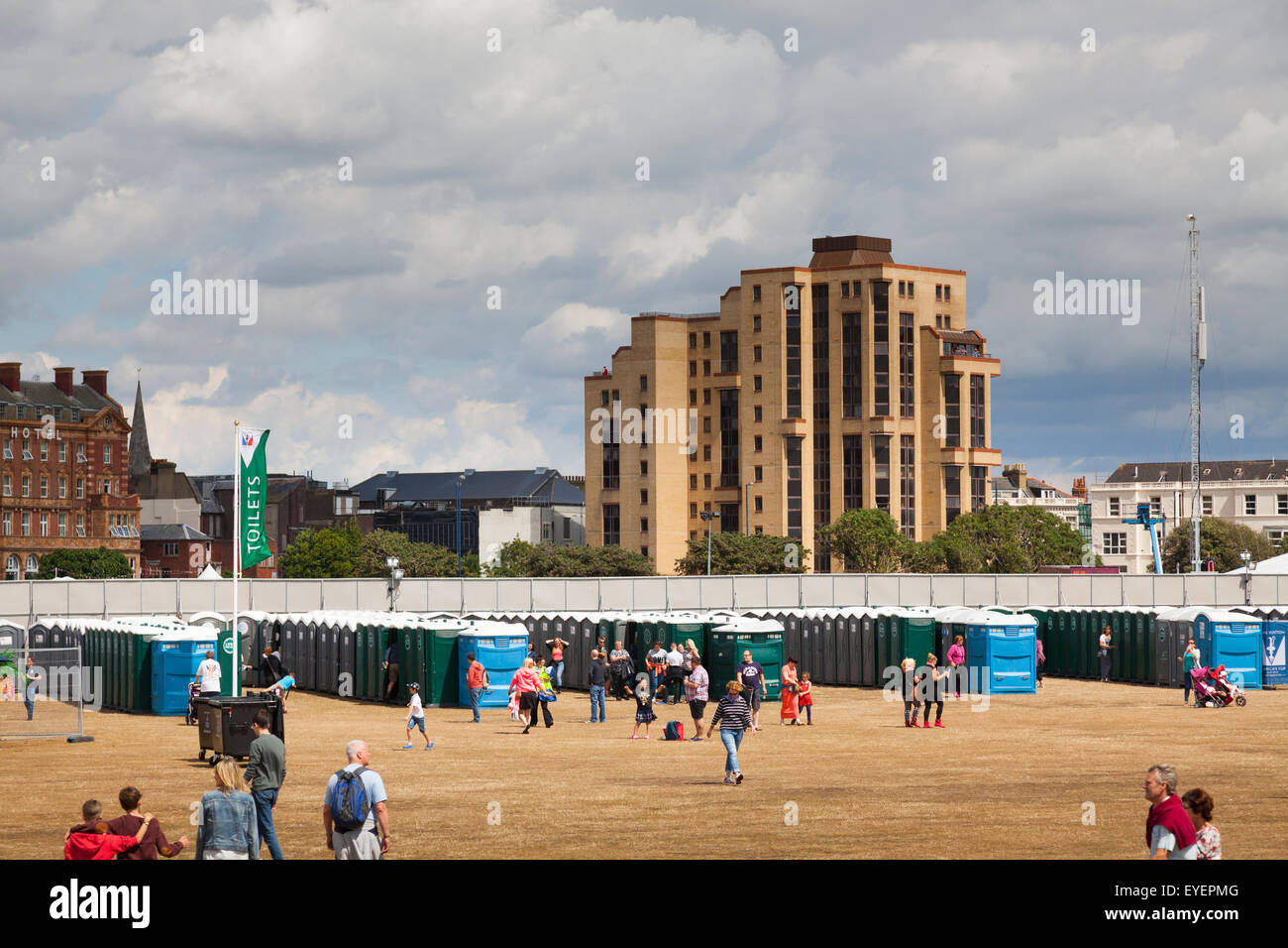Rows of portable toilets on Southsea Common for a crowd event Stock Photo
