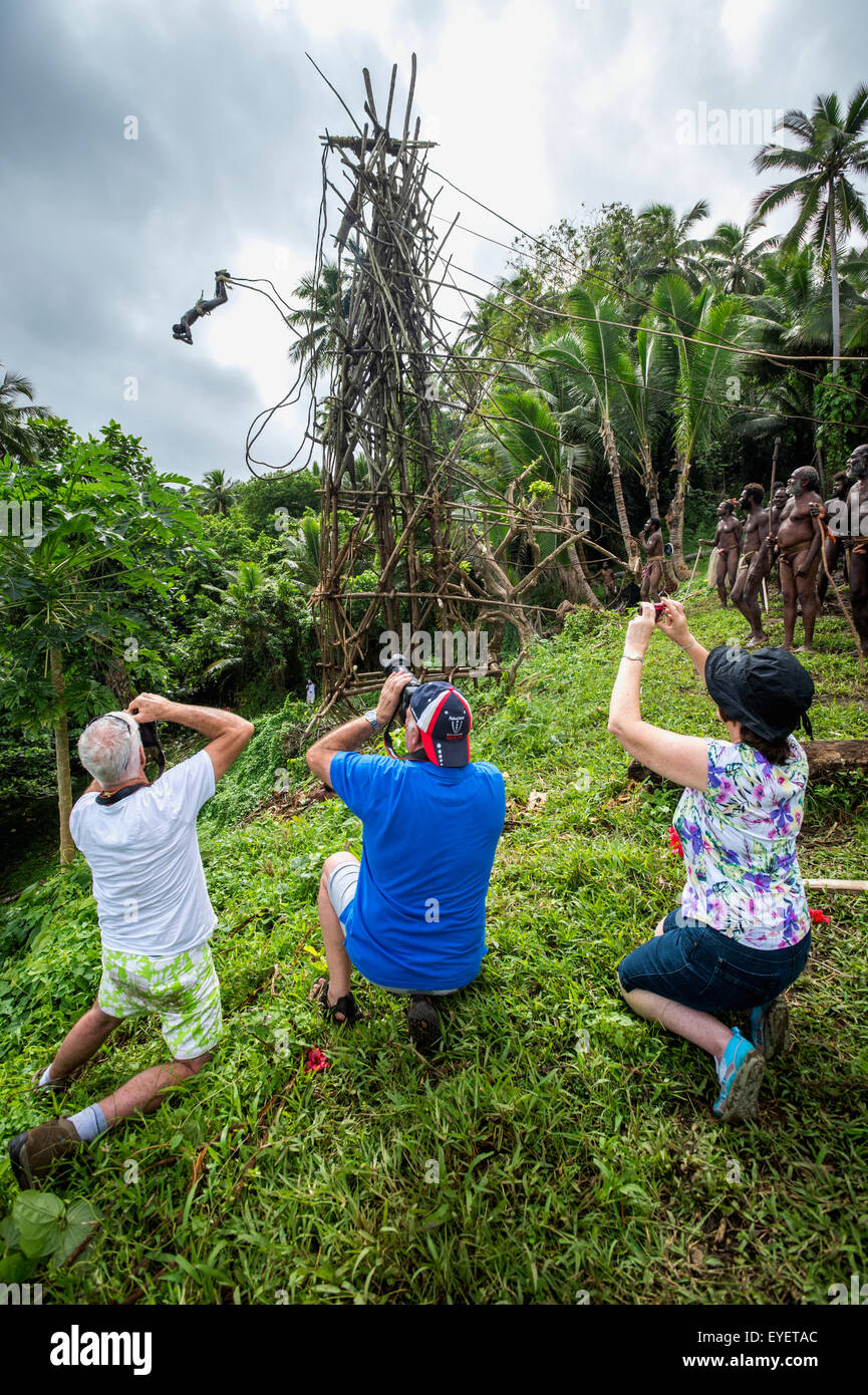Tourists photographing the land diving ceremony; Pentecost Island, Vanuatu - Stock Image