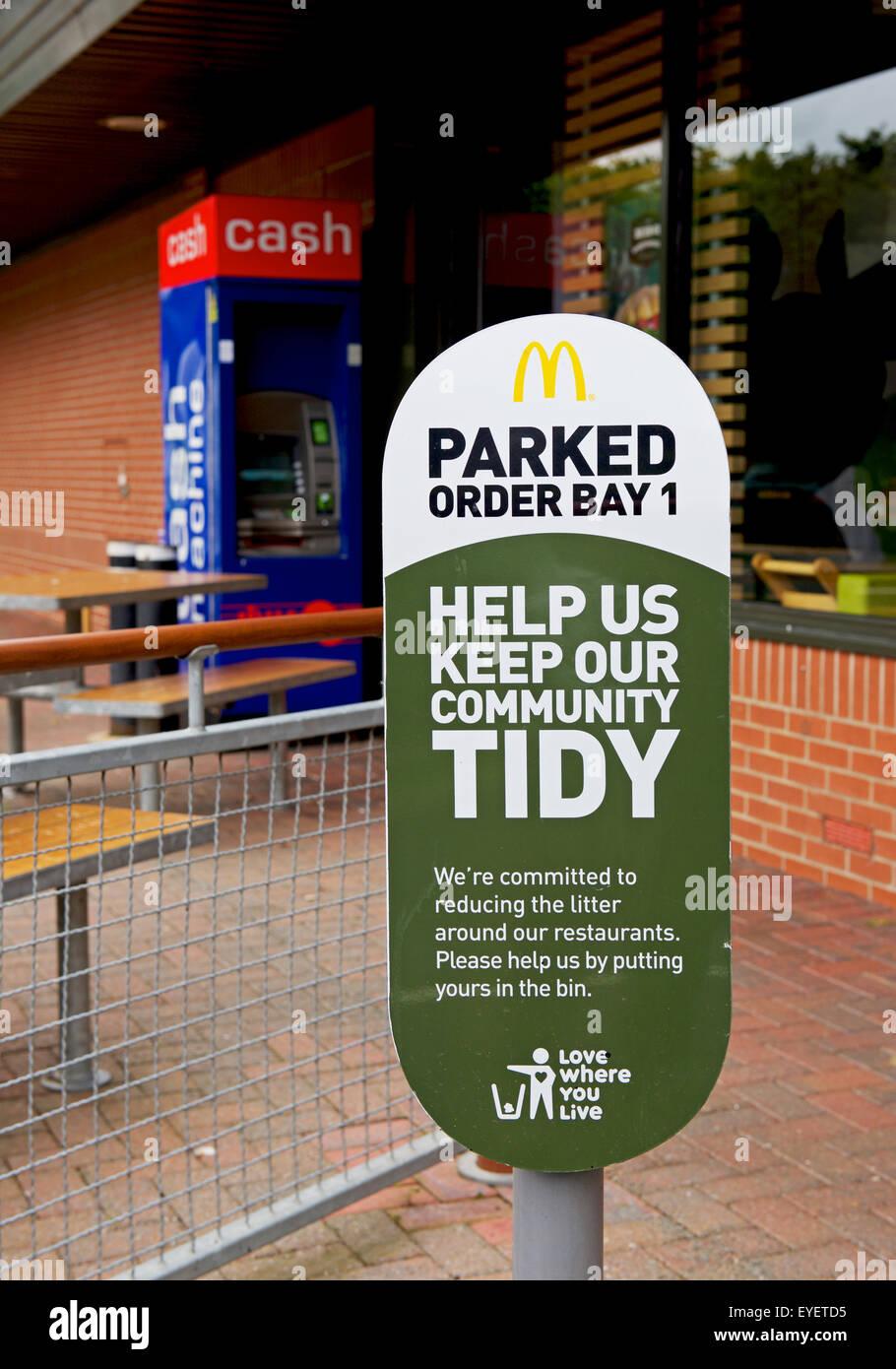 Sign outside McDonalds restaurant asking customers not to leave litter, UK - Stock Image