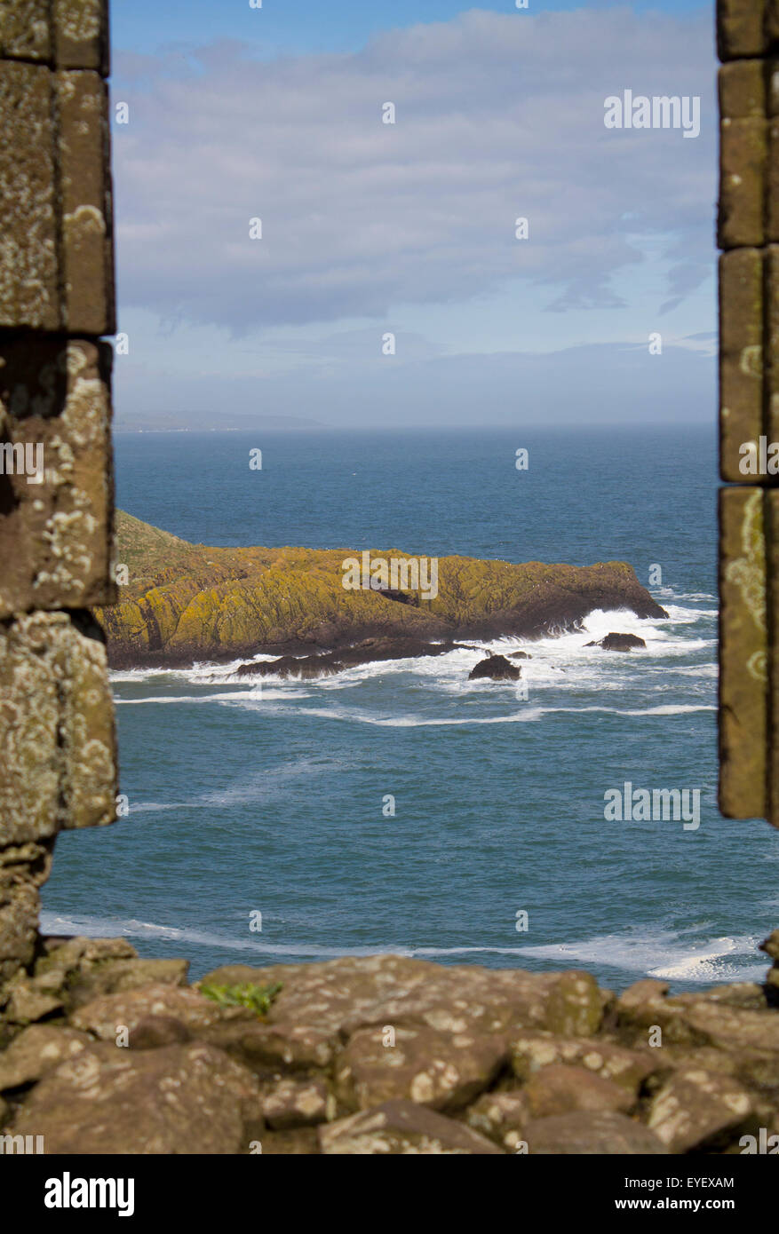 A view of the sea from a timeworn building. - Stock Image