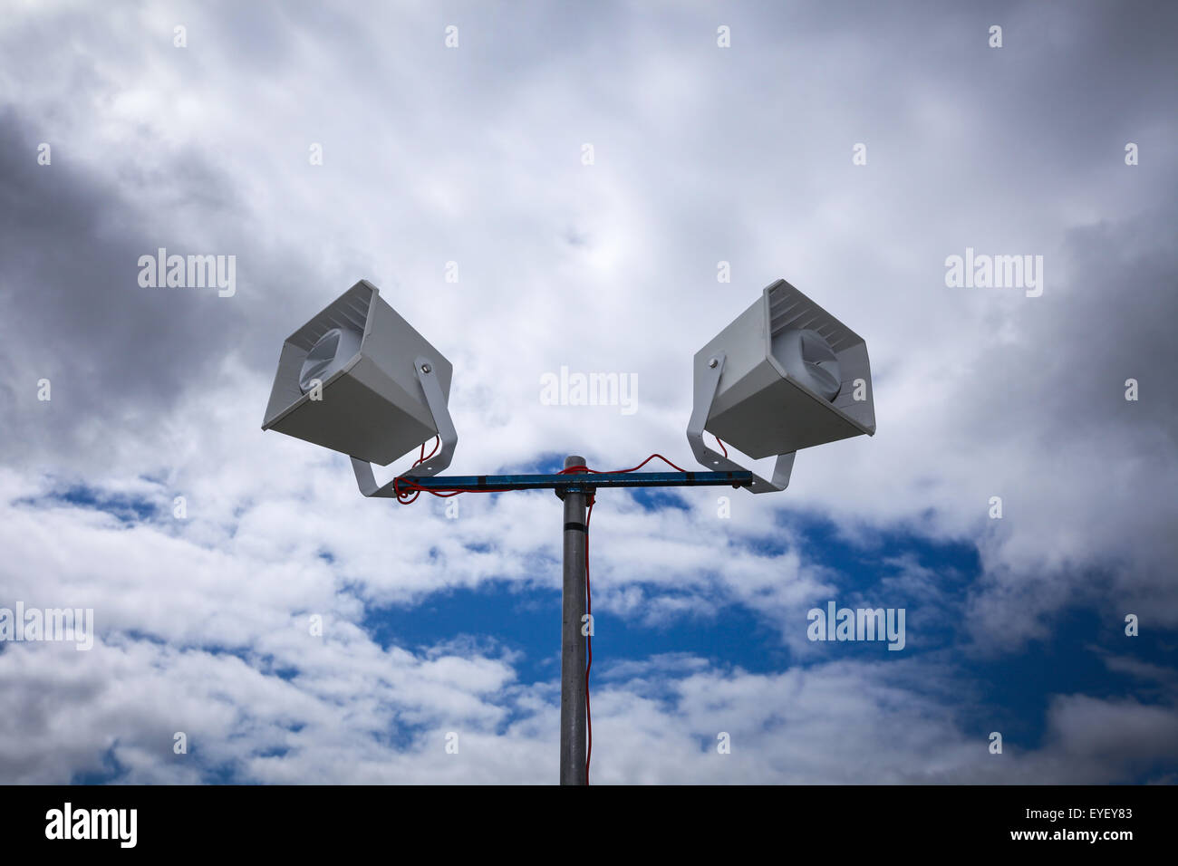 public address system PA system in front of a dramatic cloudy sky - Stock Image