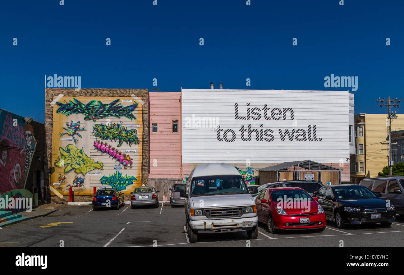 Billboard with slogan 'Listen To This Wall '  in a car parking lot in the Haight Ashbury District Of San - Stock Image