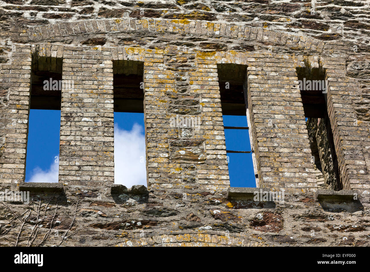 Detail of Four Windows and Arch Lintel on the Historic Gable End Ruins to the Engine House of Wheal Rose Tin Mine, - Stock Image