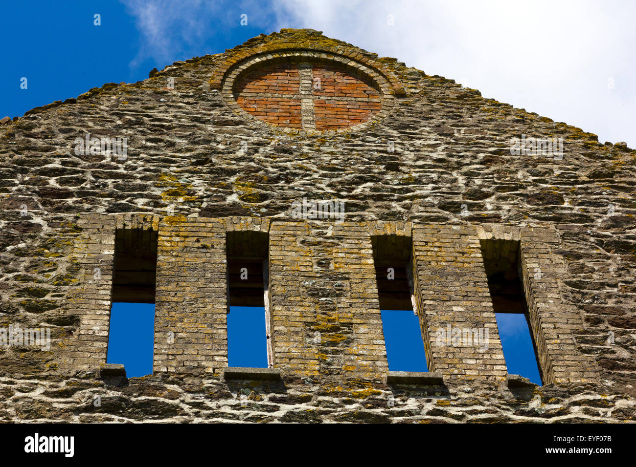 Detail of Four Window Spaces, Inlaid Cross, Arched Lintel and Wall Construction at the Ruined Gable End, Wheal Rose - Stock Image