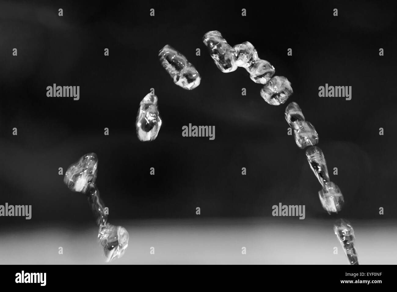 Water drop falling to the fountain - Stock Image