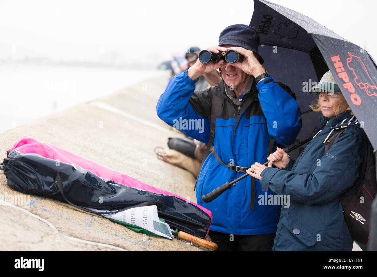 Rain soaked fans watch the six competing AC45 foiling catamarans during practice racing at the America's Cup World Stock Photo