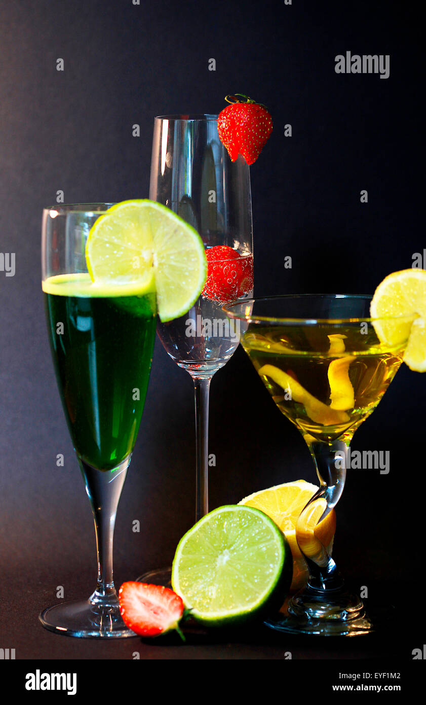 Three assorted cocktails with garnish - Stock Image