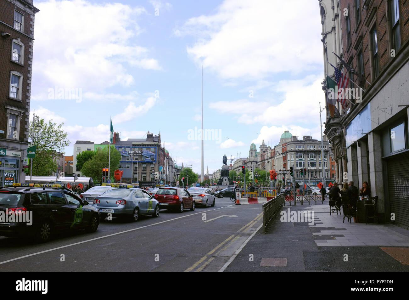 Traffic heading towards The Spire of Dublin. - Stock Image