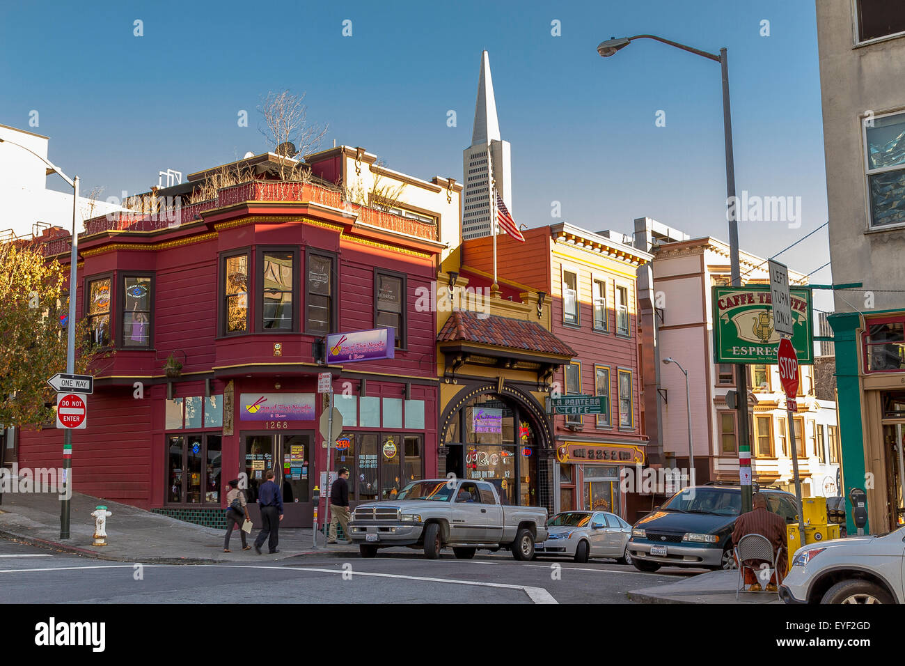 North Beach Street scene at Sunset with The Transamerica Pyramid  looming over the rooftops San Francisco,California, Stock Photo