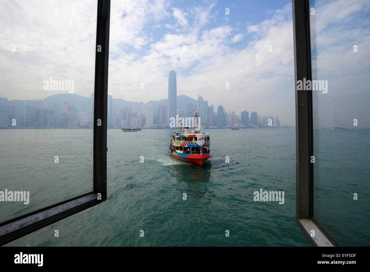 Star Ferry arriving at Tsim Sha Tsui terminal; Hong Kong - Stock Image