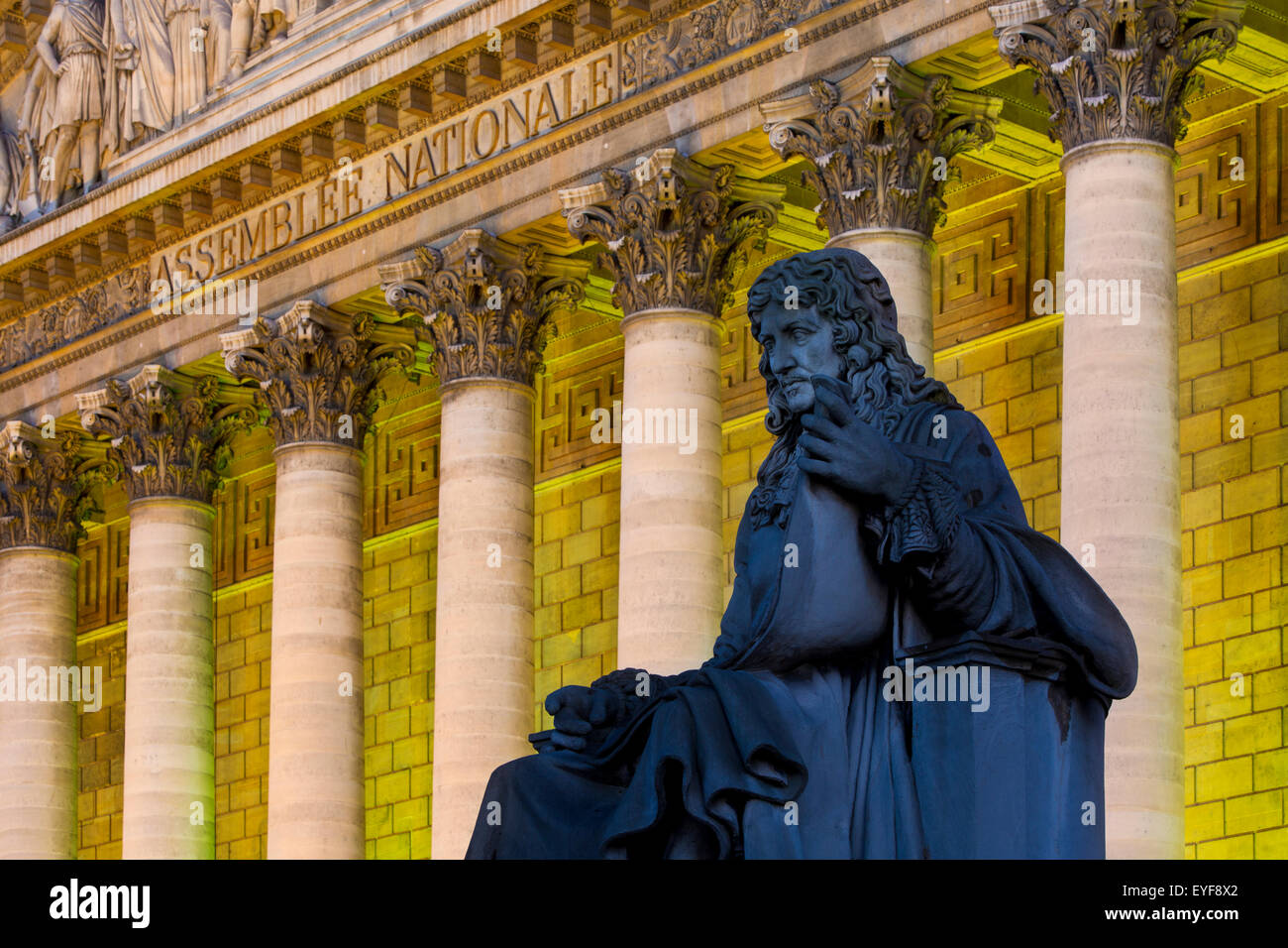 Evening below Jean-Baptiste Colbert statue and the Assemblee Nationale, Paris, France - Stock Image