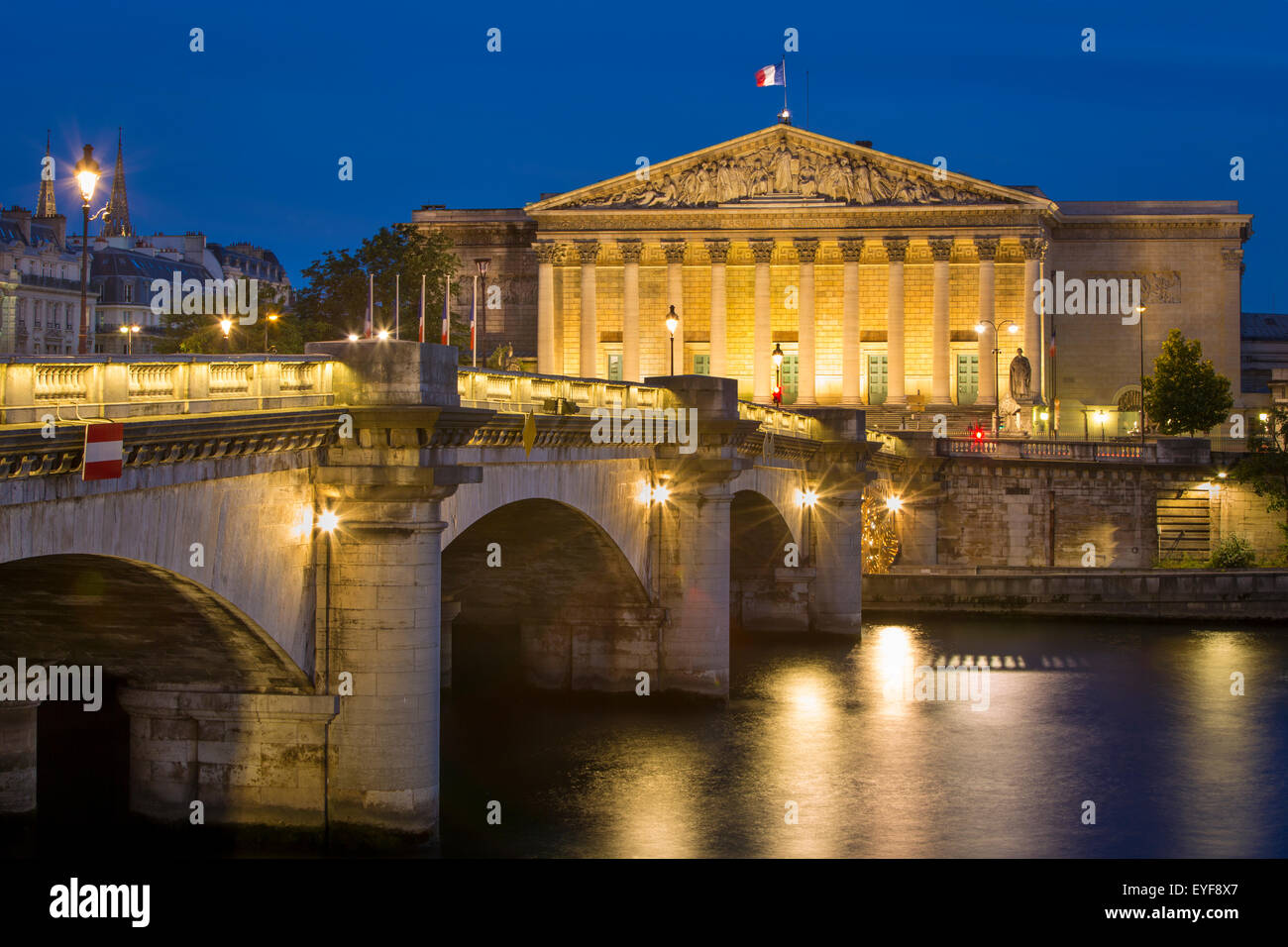 Twilight view over River Seine, Pont de la Concorde and Assemblee Nationale, Paris, France - Stock Image