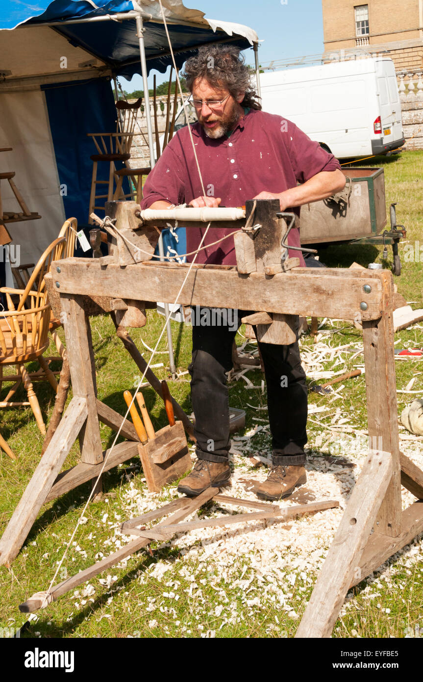A demonstration of wood turning using a pole lathe at Holkham Country Fair in Norfolk. - Stock Image