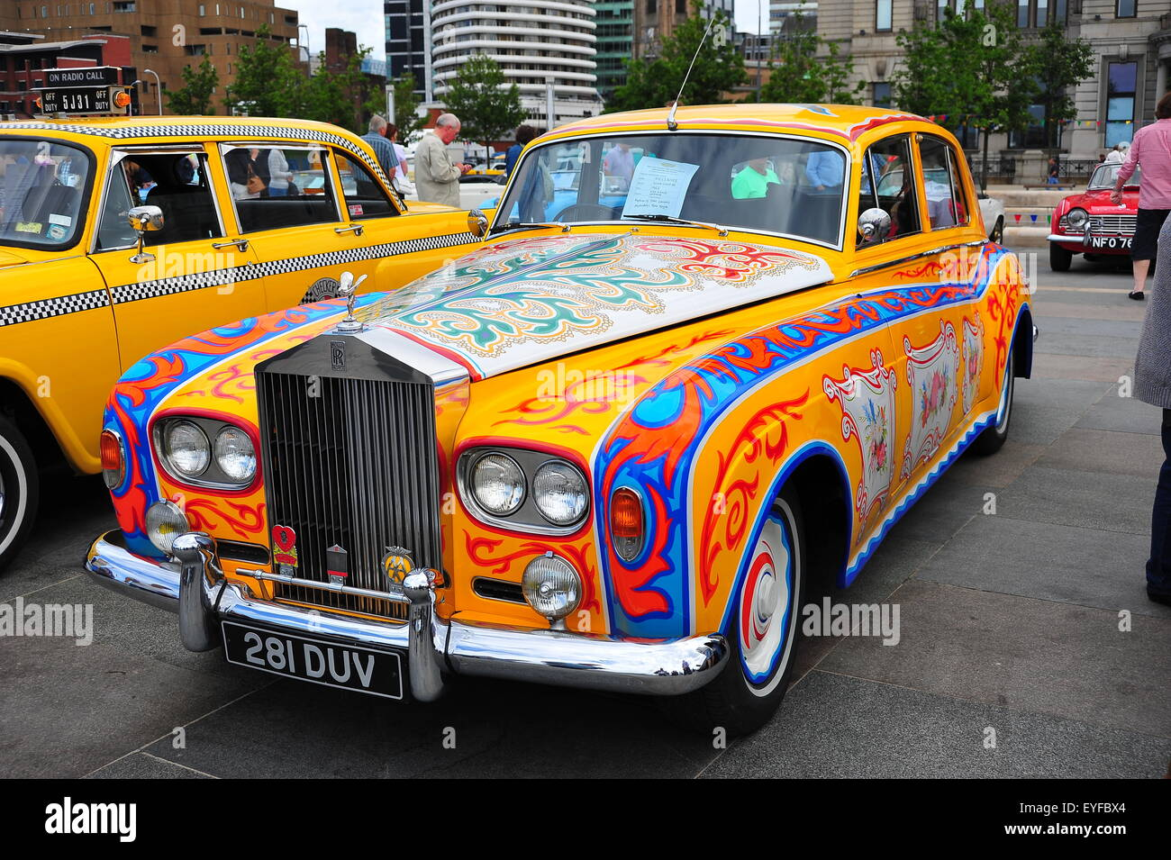 Rolls Royce with psychedelic paint scheme on show at Liverpool's Pier Head. - Stock Image