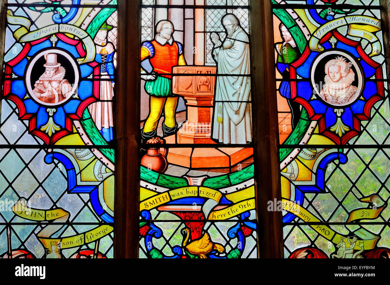 Stained glass window in the parish church in Willoughby, Lincolnshire,UK. It depicts the christening of John Smith - Stock Image