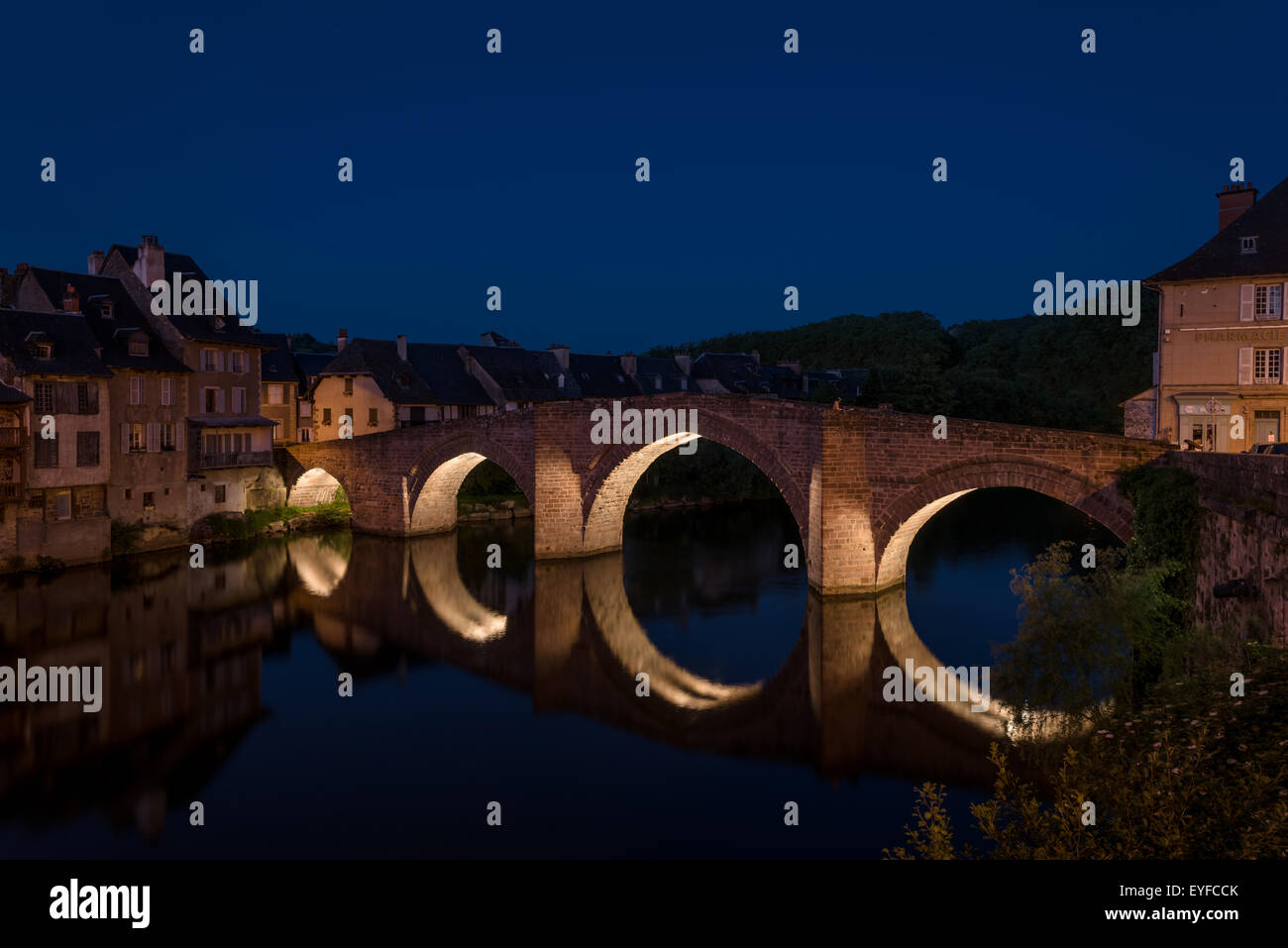 Old Bridge and River Lot at Night, Espalion, France Stock Photo