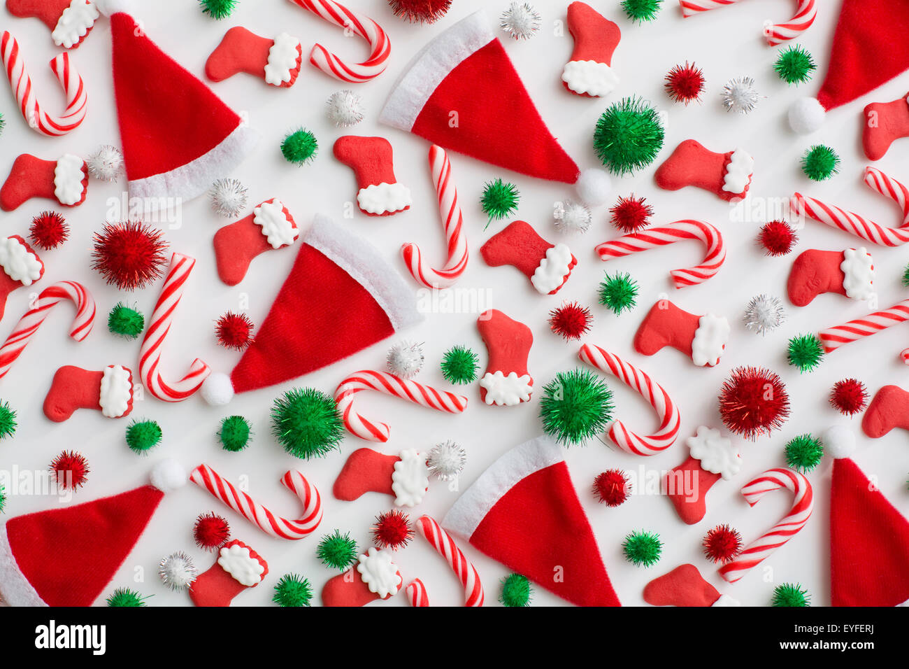 Christmas decoration of santa hats, candy canes and Christmas stockings - Stock Image