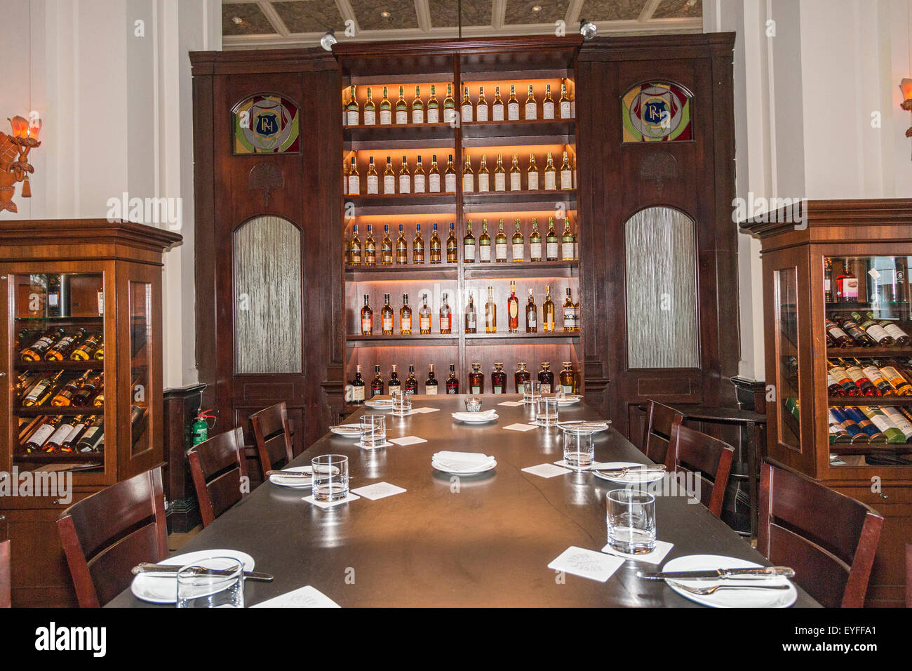 Bar and Billiard Room of Raffles Hotel, which was built in 1887 and has become Singapore's best known icon. - Stock Image