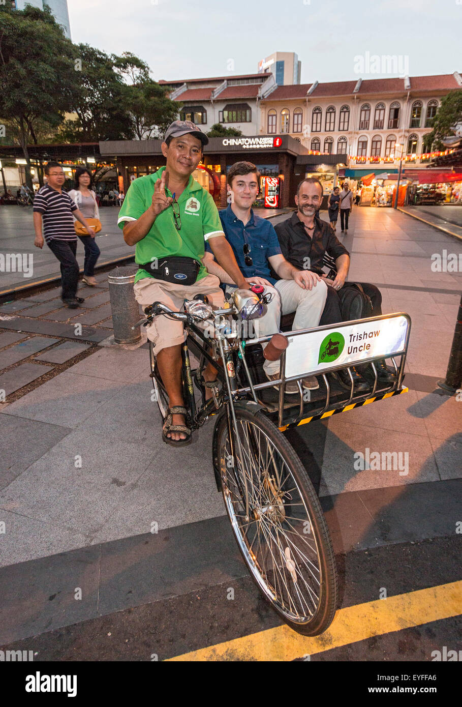 Trishaw ride in downtown Singapore. - Stock Image