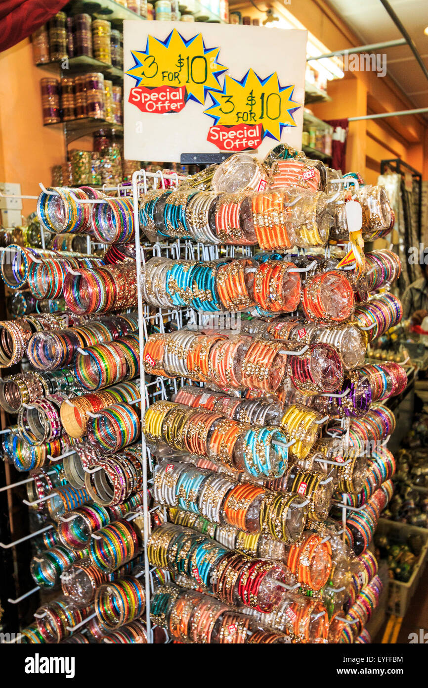 Bangle bracelets for sale in Singapore's Little India district. - Stock Image