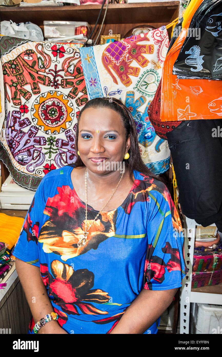 Local shopkeeper woman in a scarf shop in Singapore's Little India district. - Stock Image